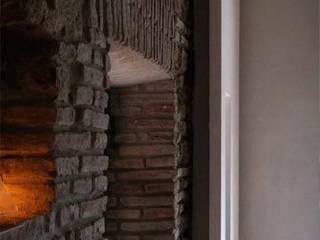 Rustic style living room by maurizio pappalardo romina fava Rustic
