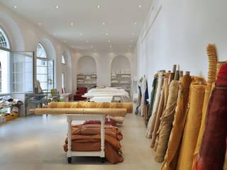 C&C SHOWROOM Negozi & Locali commerciali moderni di FTA Filippo Taidelli Architetto Moderno