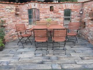 Rimini Baustoffe GmbH Rustic style garden