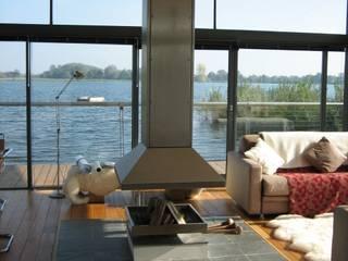 AR Design Studio- The Boat House: modern Living room by AR Design Studio