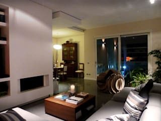 Appartamento F: Soggiorno in stile  di Blocco 8 Architettura