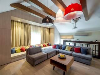 Мансарда в загородном доме Гостиные в эклектичном стиле от Uniquely Эклектичный