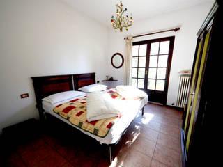 Dormitorios de estilo  por Marco Barbero