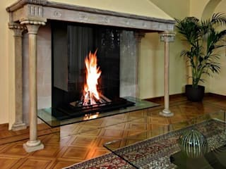 Modern glass fireplace inside an original Italian style fireplace Bloch Design SalonesChimeneas y accesorios