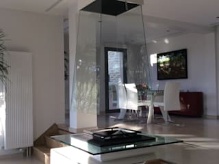 Pyramidal glass fireplace Bloch Design SalonesChimeneas y accesorios