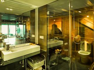 Reforma de un despacho profesional para un actor: Baños de estilo  de Pablo Echávarri Arquitectura
