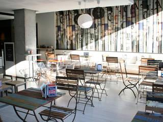 Una panadería de mucho etilo:  de estilo  de Estudio Sergio Castro arquitectura