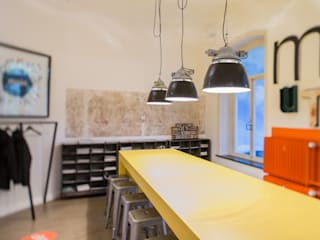 Industrial style offices & stores by func. functional furniture Industrial