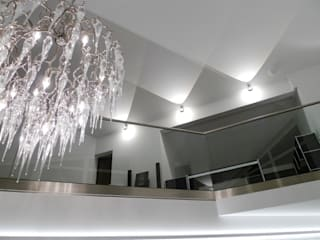 Modern Corridor, Hallway and Staircase by Bolz Licht und Wohnen · 1946 Modern