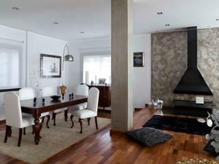 Vivienda unifamiliar: Salones de estilo moderno de  BB INTERIORISMO
