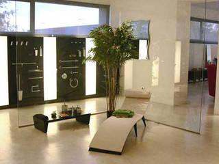 Show room Pom d'or: Negozi & Locali commerciali in stile  di Lucarelli Rapisarda Architettura & Design