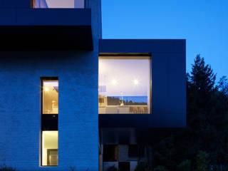 tra le foglie, casa p: Case in stile in stile Eclettico di bergmeisterwolf architekten