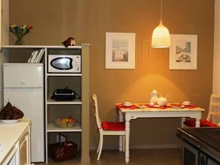 cucina rinnovata e mobili di recupero Cucina in stile rustico di VALENTINA BONANDIN STUDIO TECNICO Rustico
