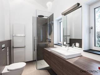 Modern bathroom by ONE!CONTACT - Planungsbüro GmbH Modern