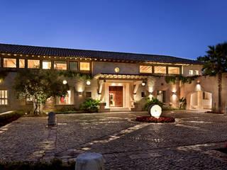 Fachada : Casas de estilo  por Artigas Arquitectos