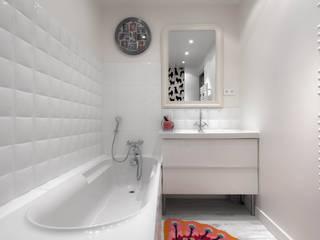 Baños de estilo minimalista por homify