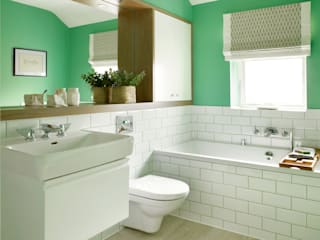 Baños de estilo ecléctico por Amory Brown Ltd