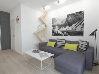 Salones de estilo moderno de WNĘTRZNOŚCI Projektowanie wnętrz i mebli Moderno