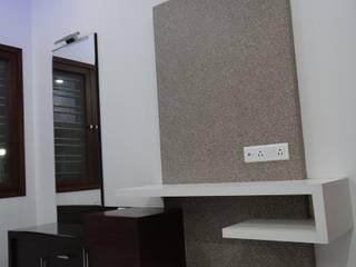 Master bedroom tv unit:  Bedroom by Hasta architects