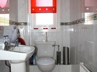 Casas de banho  por Isolution Interiors