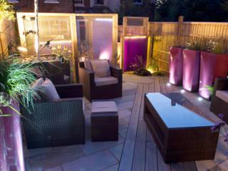 Party garden in Sevenoaks, Kent モダンな庭 の Earth Designs モダン
