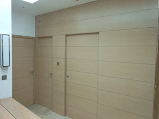 Combination of doors and panelling:   by Modern Doors Ltd