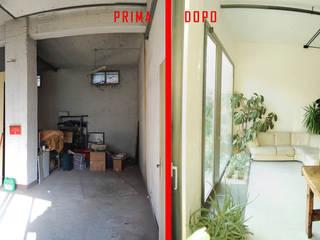 DOCK_52_da garage a residenza: Soggiorno in stile in stile Industriale di laprimastanza