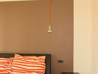 l.o.f.t. Camera da letto in stile industriale di deltastudio Industrial