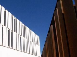 Unidad Integral Ambulatoria de Hospital de Elche:  de estilo  de TallesArquitectura