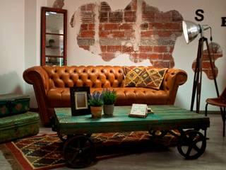 Salón de estilo vintage.: Salas de estilo  por Noelia Ünik Designs
