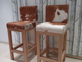 Cowhide Bar & Kitchen Stools: modern  by Hide and Stitch, Modern