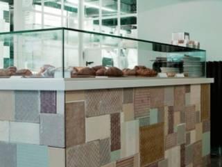 PAVE' bakery: Spazi commerciali in stile  di Principioattivo Architecture Group Srl