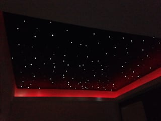 Starlight ceiling in 'movie room': modern Living room by Lancashire design ceilings
