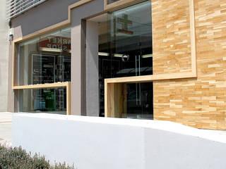 PHARMACY IN CRETE Spazi commerciali in stile minimalista di FPAA / Fiori Pietrapiana Architetti Associati Minimalista