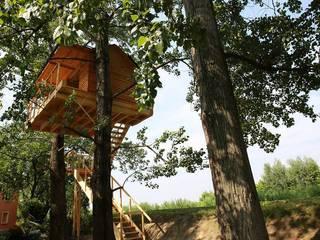 Treehouse:  in stile  di Nicola Preti - Architecture, Planning and Preservation-