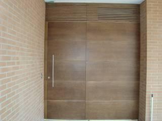 Puertas con estilo y diseño propios:  de estilo  de GASENI-fusteria i mobles scp ( Armaris Gaseni )