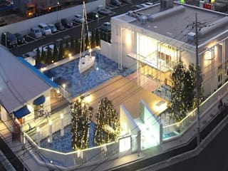 Casas de estilo moderno por ユミラ建築設計室