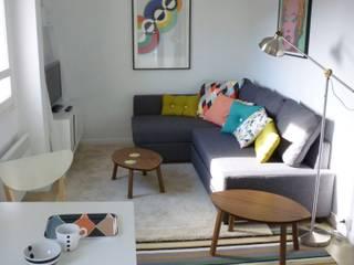Décoration appartement meublé : Salon de style  par Emmanuelle Diebold