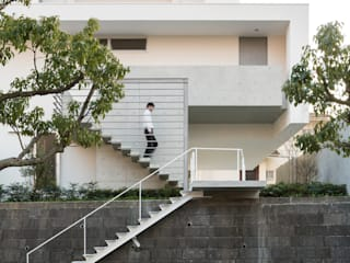 Casas de estilo  por Kenji Yanagawa Architect and Associates