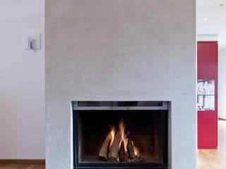 Kamingestaltung als Highlight Moderne Wohnzimmer von Einwandfrei - innovative Malerarbeiten oHG Modern