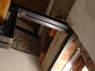 casa B: Case in stile in stile Moderno di ellenia+tre architettura e ingegneria