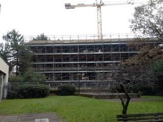 Edificio residenziale via Brambilla Cinisello B.mo:  in stile  di Studio Guzzo & Partner