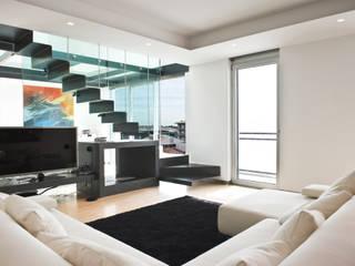 Attico Prestige: Case in stile in stile Moderno di Studio Merlini Architectural Concept