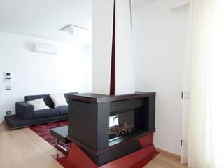 Casa LM: Soggiorno in stile  di Laboratorio di Progettazione Claudio Criscione Design