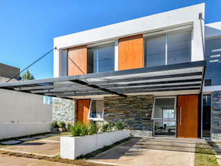 CASAS ADOSADAS Casas modernas: Ideas, imágenes y decoración de Estudio A+3 Moderno