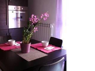 Zona pranzo: Case in stile in stile Moderno di Barbara Balzani Architetto