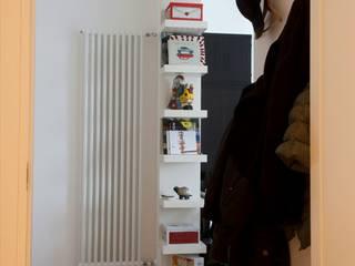 """""""CASET'TINA"""" CONVERSIONE DA UFFICIO AD APPARTAMENTO RESIDENZIALE. COMPLETA RIQUALIFICAZIONE INTERNA. Case moderne di Ferretti Studio Moderno"""