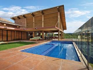 Casa da Montanha 2: Casas  por David Guerra Arquitetura e Interiores,Rústico