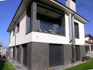 fachada:  de estilo  de Muneta Arquitectura S.L.P.