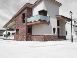 VIVIENDA CORCOBADO de BM2C Arquitectos Moderno